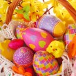 Easter basket with colorful eggs — Stock Photo #9483370