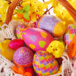 Easter basket with colorful eggs — Stock Photo