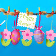 Easter border with hanging eggs — Stock Photo