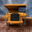 Huge auto-dump yellow mining truck — Stock Photo