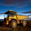 Huge auto-dump yellow mining truck night shot and excavator — Stock Photo #8767079