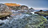 Coast landscape colorful sea rock mountain twilight — Stock Photo