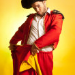 Bullfighter courage red yellow humor spanish colors - Stock Photo