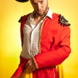 Bullfighter courage red yellow humor spanish colors — Stock Photo