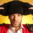 Bullfighter putting on big montera hat humor spanish colors - Stock Photo