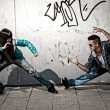 图库照片: Young urban couple dancers hip hop dancing fight acting urban scene