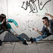 Stock Photo: Young urban couple dancers hip hop dancing fight acting urban scene