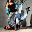 Stock Photo: Young urban couple dancers hip hop dancing urban scene