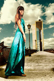Young woman fashion outdoor cross processing dress urban scene — Stock Photo