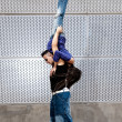 Young urban couple dancers hip hop dancing urban scene — Stock Photo