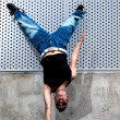 Young male dancer hip hop dancing urban scene — Stock Photo