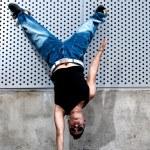 Young male dancer hip hop dancing urban scene — Stock Photo