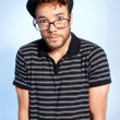 Young man modern nerd wide angle portrait blue background — Stock Photo