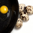 Royalty-Free Stock Photo: Quail eggs on black pan