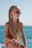 The girl in pink glasses with the African plaits. A portrait — Stock Photo