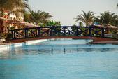 The bridge through pool in hotel territory. Egypt. Hurgada. — Stock Photo
