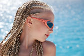 The girl in pink glasses with the African plaits — Stock Photo