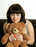 The girl with a toy bear cub — Stock Photo