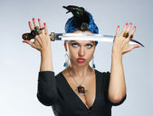 The girl in a turban with a dagger — Stock Photo
