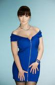 The beautiful brunette in a dark blue dress — Stock Photo