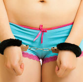 Girl in panties and handcuffs isolated on white — Stock Photo