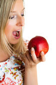 Beauty blond girl with apple isolated on white — Stock Photo
