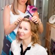 Woman curling hair - Stock Photo