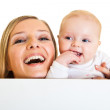 Isolated beaufiful caucasian infant baby behind whiteboard — Stock Photo
