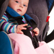 Infant child sitting in car seat — Stock Photo