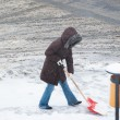 woman shoveling snow — Stock Photo