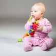 Cute infant baby girl sitting on the floor — Stock Photo #9447468