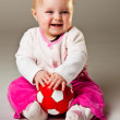 Cute infant baby girl sitting on the floor — Stock Photo