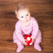 Cute infant baby girl sitting on the floor — Stock Photo #9447528