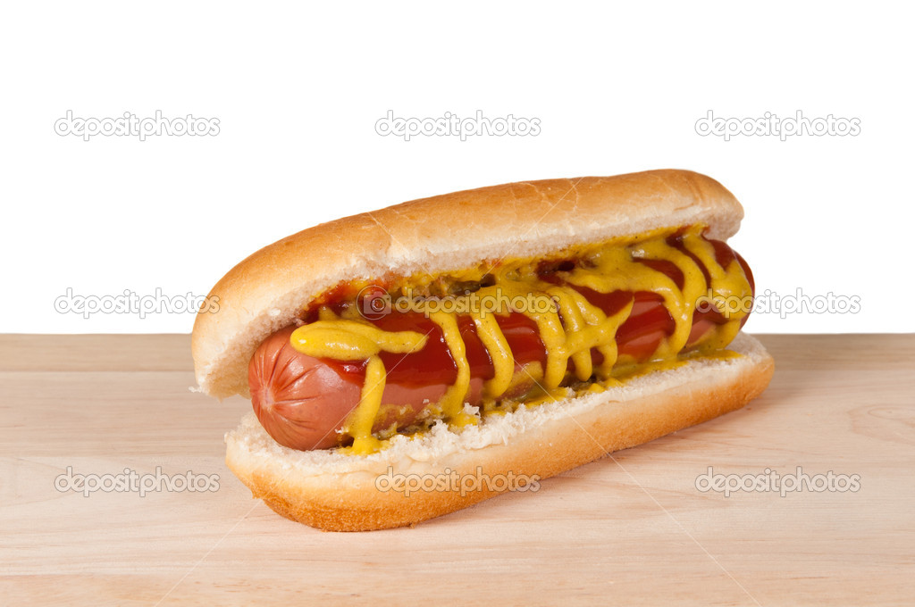 Homemade hot dog on a wooden board — Stock Photo #10501143