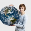 Boy holding the planet earth — Stock Photo #10170252