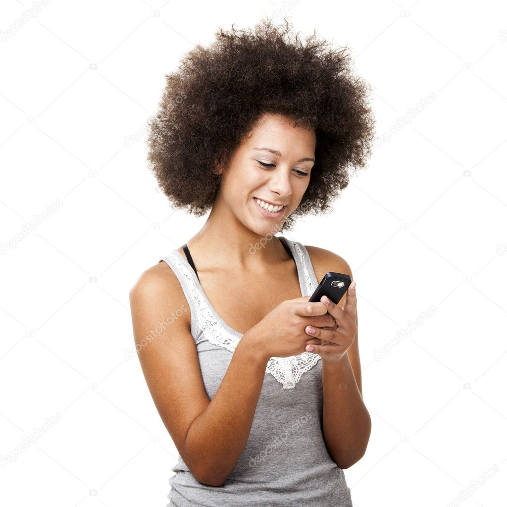 Beautiful African American woman sending a sms on cell phone, isolated on white background — Stock Photo #10170118