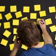 Writing a paper note - Stockfoto