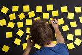 Writing a paper note — Stock Photo