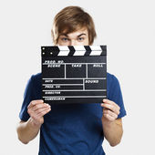 Showing a clapboard — Stockfoto