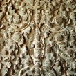 Stock Photo: Sculpted wall at corridor of Angkor Wat, Cambodia
