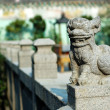Stone lion of Chinese temple — Stock Photo