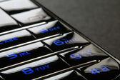 Blue mobile keypad under dark — Stock Photo