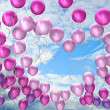 Heart symbol, flying colorful balloons — Stock Photo