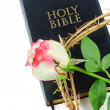 Stock Photo: Holy bible and crown of thorns with rose isolated on white background