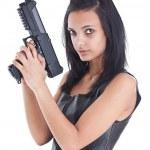 Woman is aiming a handgun — Stock Photo