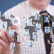 Businessman pressing modern social buttons — Stockfoto