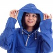 Young women in a blue rain coat — Stock Photo
