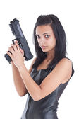 Woman is aiming a handgun — Stockfoto