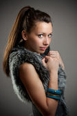 Girl in a fur coat — Stock Photo