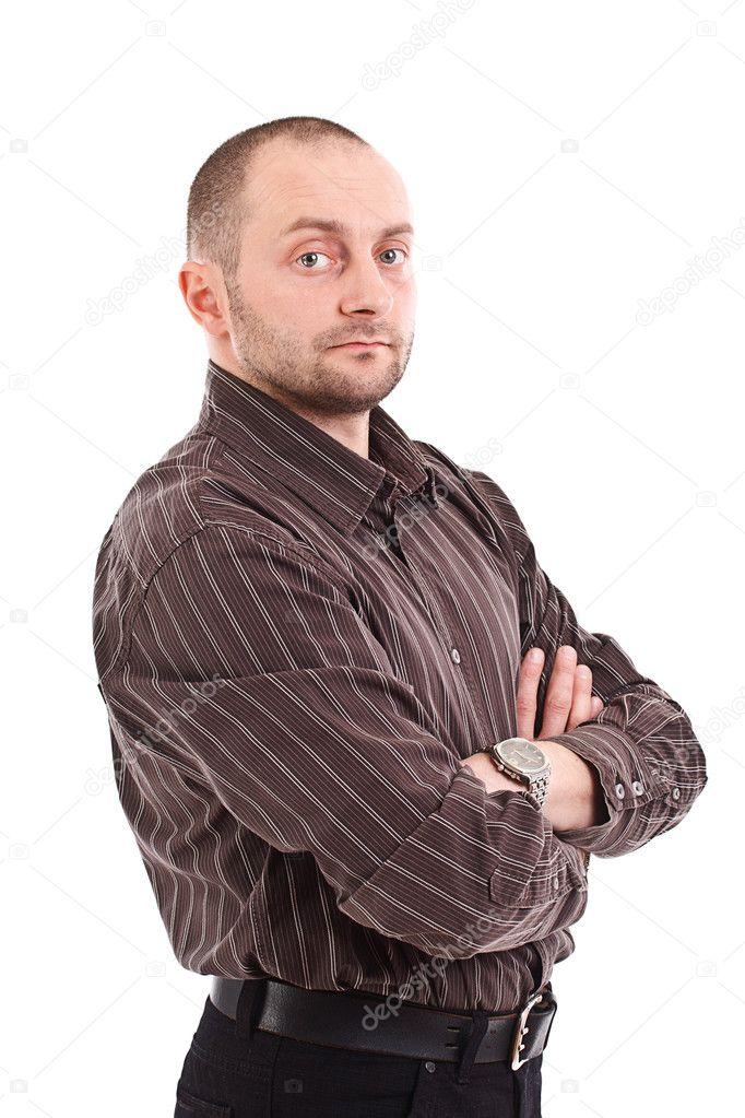 Casual young businessman standing arms crossed  Stock Photo #10576977